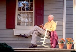 elderly man rocking at home